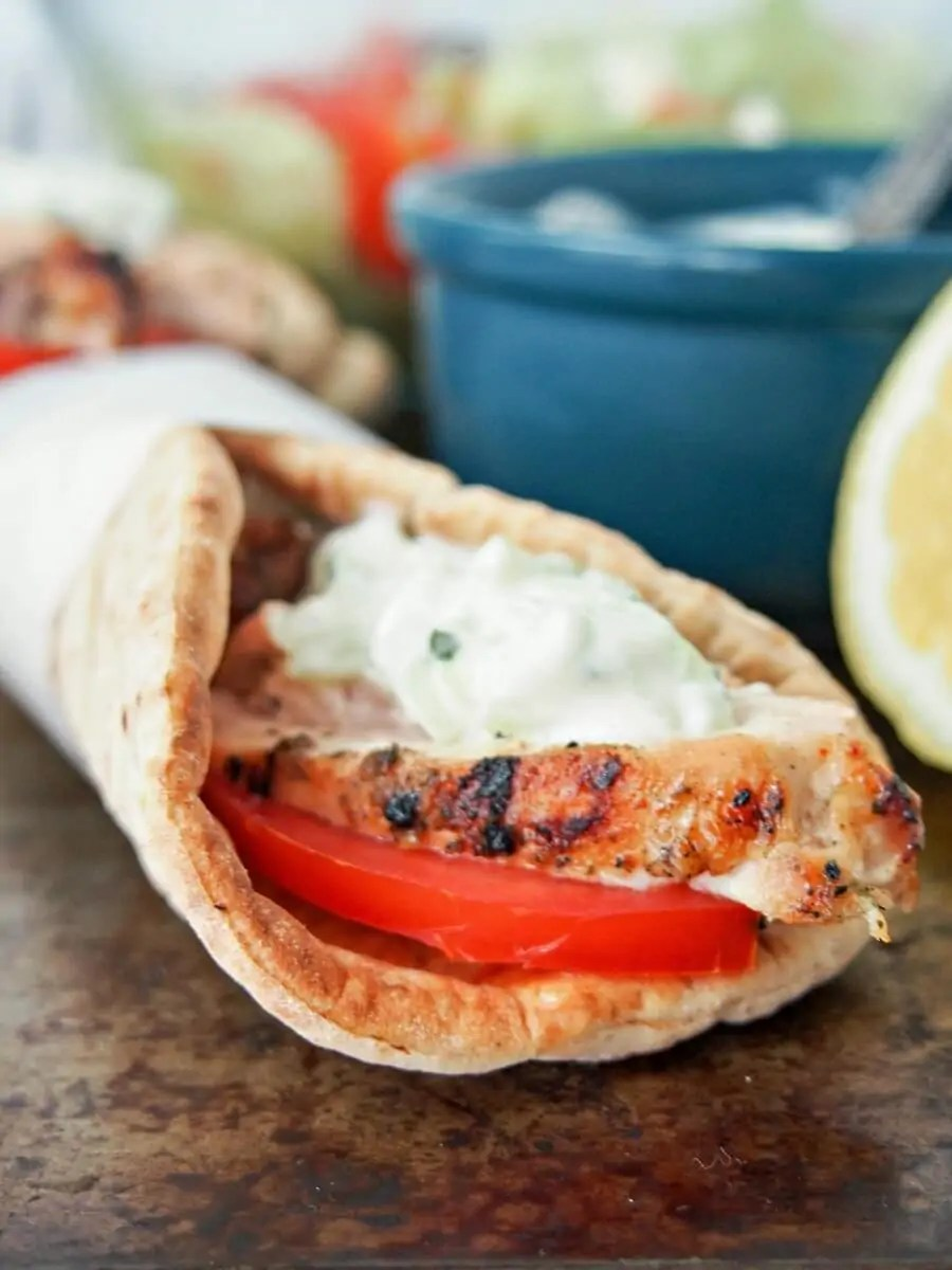 Chicken gyros combine tender, marinated chicken grilled to perfection, with creamy tzatziki and tomato wrapped in pitta bread. It's an easy meal all will enjoy.