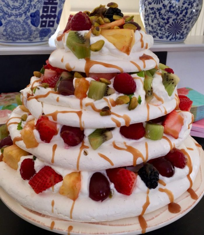Pavlova with Cream, Fruit and Caramel Sauce