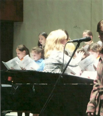 Carolyn conducting her choral piece, All We Wish is Peace. Ship of Tolerance Concert, International House of Music, Moscow