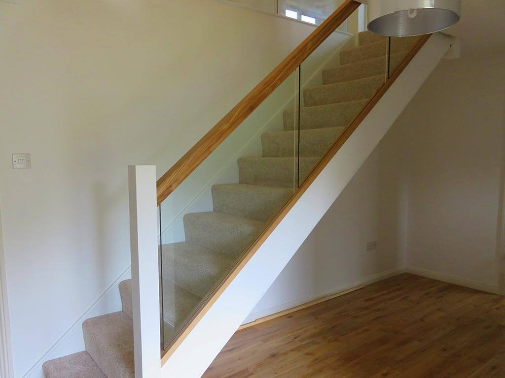 Bespoke Wood and Glass Stair Install Carpenter