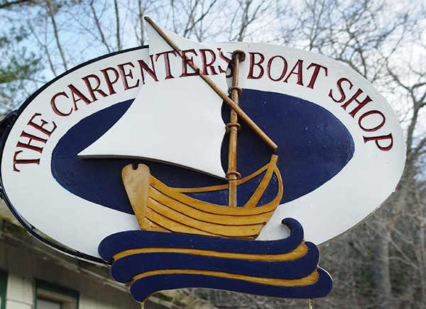 hand-carved boat shop sign