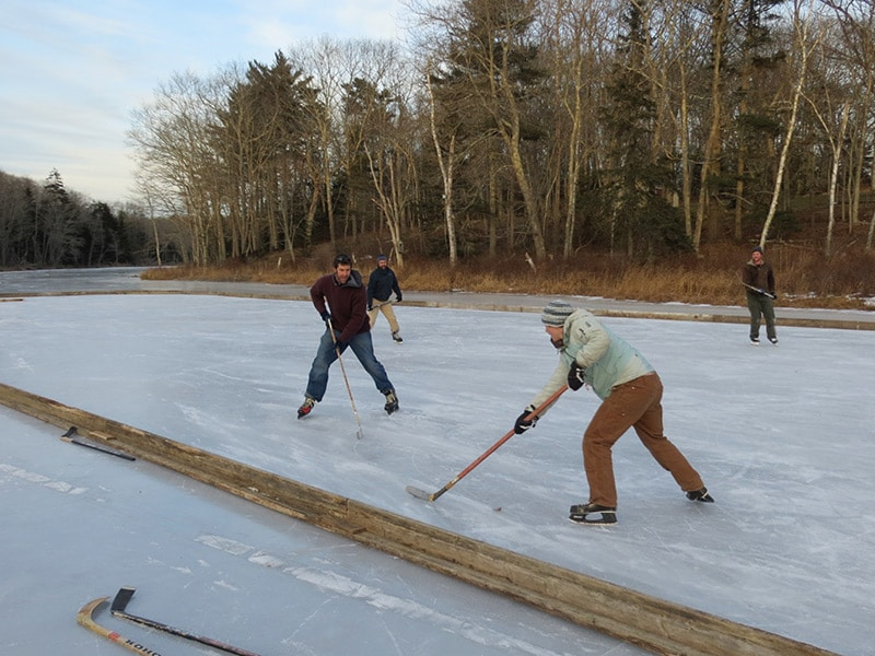 playing ice hockey on the pond