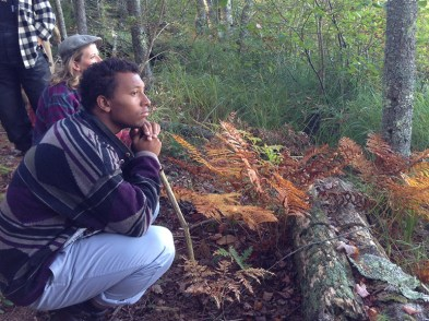 a young man reflecting in the woods
