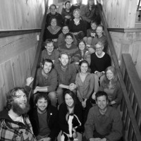 group shot on the stairs of the workshop