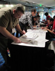 New member Steve Huffman orders displays at the Exhibit Hall