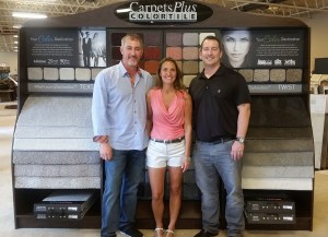 Stacey Pape (center) with co-COO's Ryan Dunn and Kevin Logue