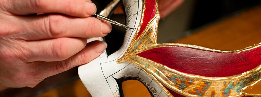 Artisan colouring a venetian carnival mask