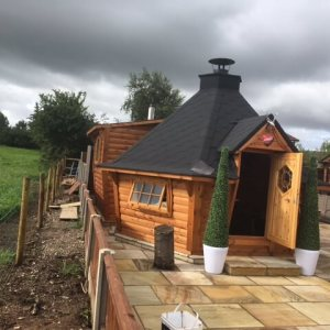 10m sloping cabin with extension, bathroom, pizza oven, bar & kitchen!