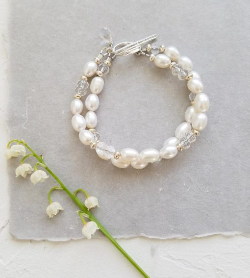 two strand white pearl and crystal quartz bridal bracelet handcrafted by Carrie Whelan Designs