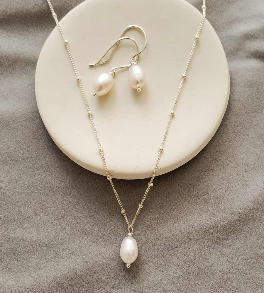 Handcrafted delicate freshwater pearl necklace and earrings set by Carrie Whelan Designs
