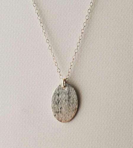 Oval brushed sterling silver pendant handcrafted by Carrie Whelan Designs