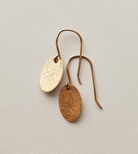 Dainty gold oval earrings handmade by Carrie Whelan Designs