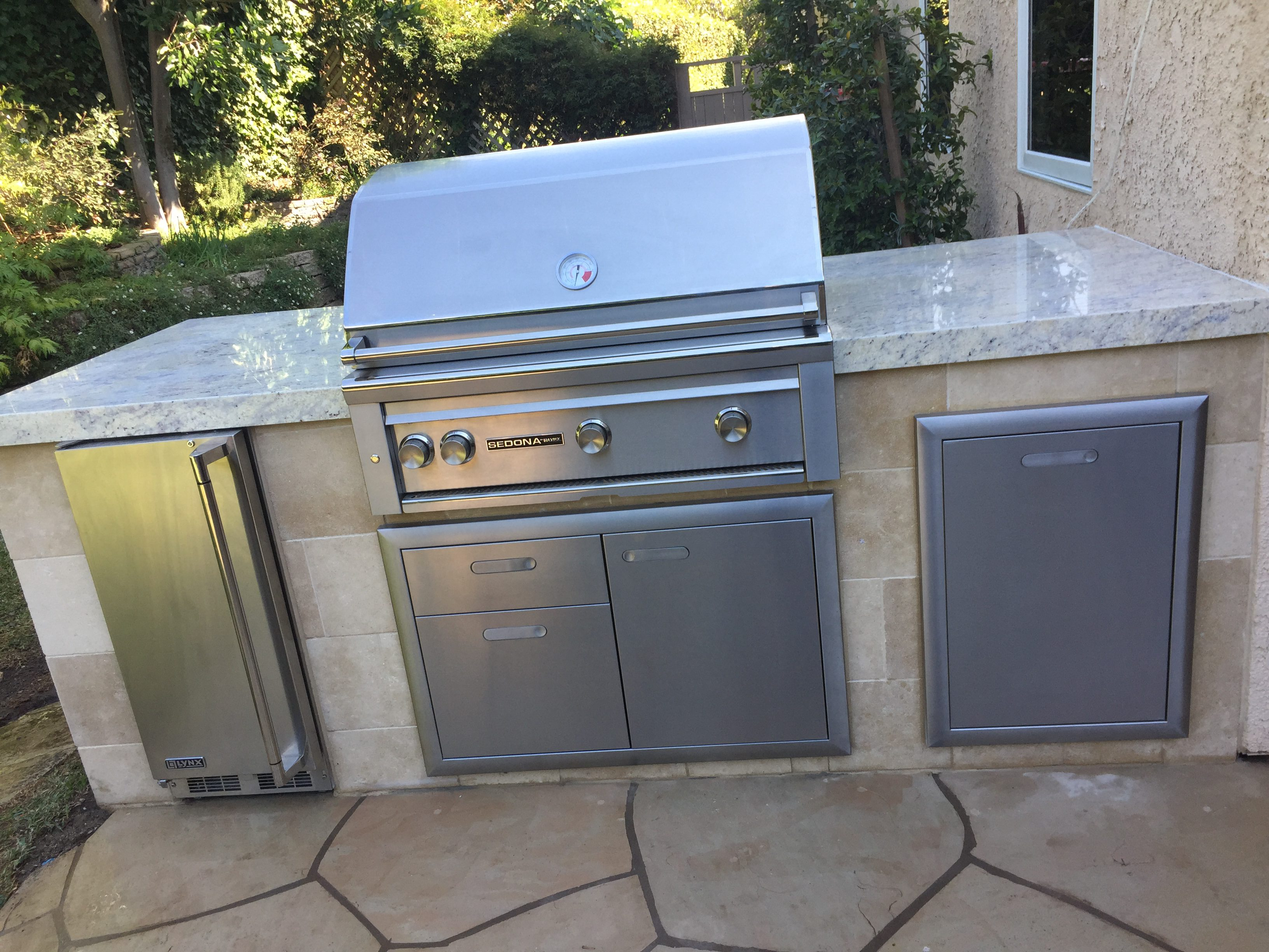Pacific Palisades Outdoor Kitchen - Granite countertop. Limestone on face of outdoor kitchen