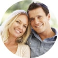 Couple smiling at dentist office