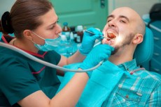 man gets dental cleaning