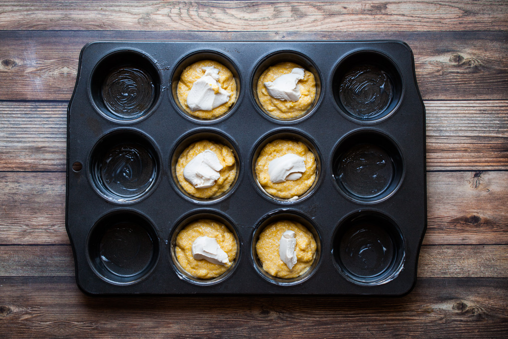 EASY 1-BOWL Vegan Cornbread Muffins! Stuffed with cream cheese + EASY to make with simple ingredients. Perfect for holiday meals, Thanksgiving, or a kid-friendly snack