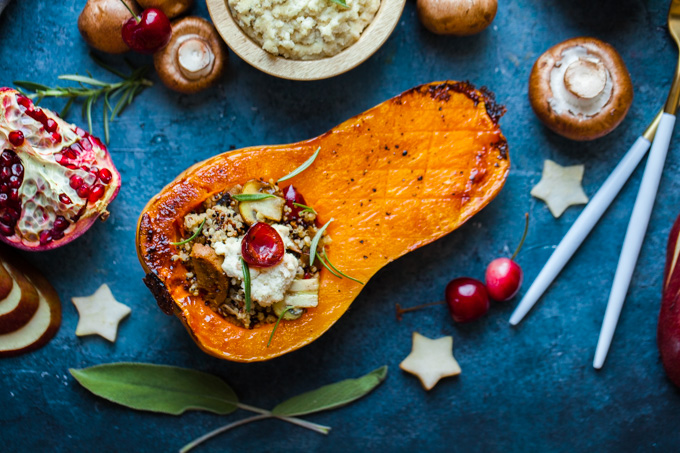 FESTIVE + Flavorful Roasted Butternut Squash stuffed with quinoa, vegan sausage, mushrooms, sage, and easy almond ricotta   The perfect side dish for your holiday dinner   Hearty enough to be a vegan main course