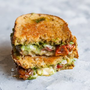 Make gourmet sandwiches for dinner in less than 10 minutes with this mega-easy Vegan Pesto Grilled Cheese - Kid-friendly, fast plant-based lunch or dinner recipe.