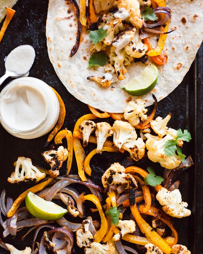 AMAZING sheet pan cauliflower fajitas! Simple ingredients + BIG flavor for an easy weeknight vegan meal.