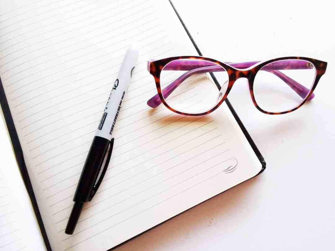 Notebook glasses and pen for writing