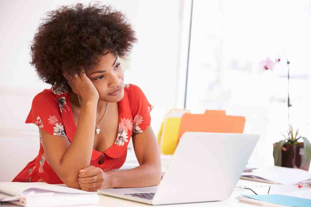 Frustrated Woman Working At Desk