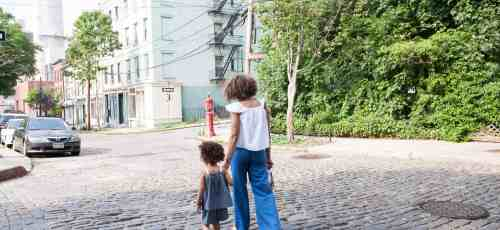 woman walks with a little girl women and money