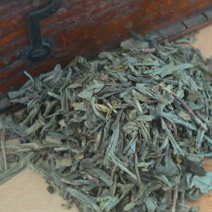 Decaffeinated green leaf tea