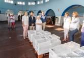 Entrega de lotes de pescado a asociaciones benéficas de Cartagena