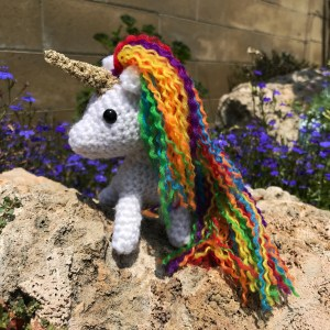 Crocheted unicorn posing for a glamour shot