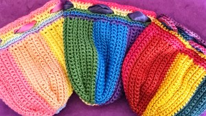 Three dice pouches in three shades of rainbow