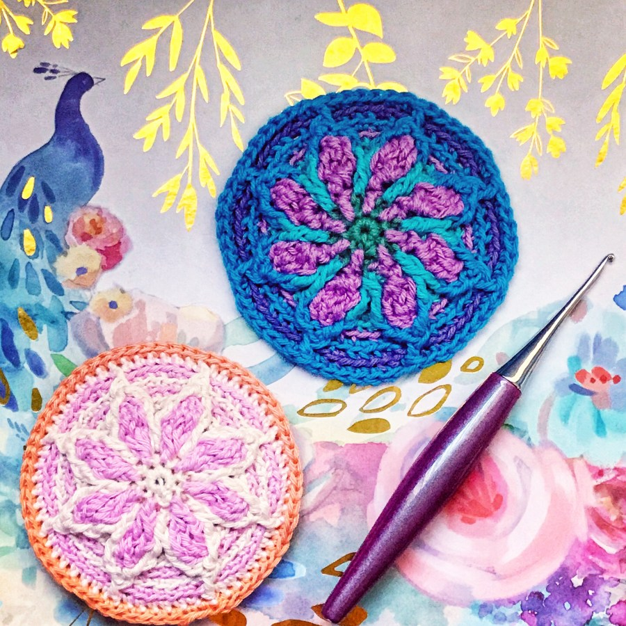 two small crochet mandalas in pink and teal