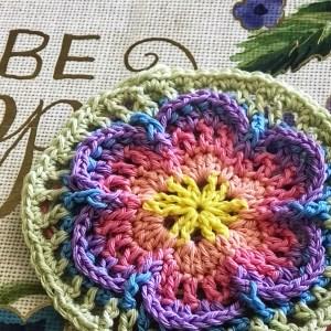 small crocheted rainbow mandala
