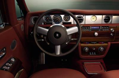 The 2009 Rolls-Royce Phantom Coupe dash is trimmed with wood and leather