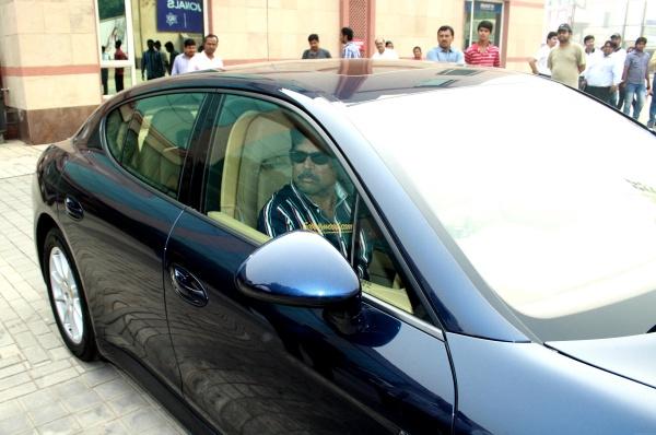 Kapil Dev in his Porsche Panamera