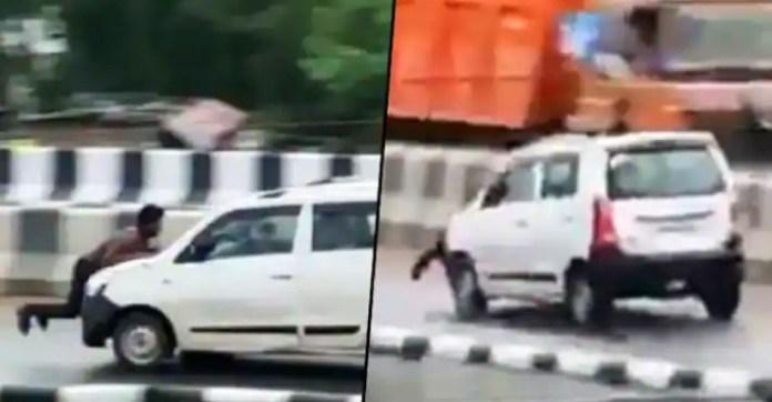 आदमी अपनी कार के बोनट पर ट्रक चालक के साथ तेज गति से गाड़ी चलाता है: पुलिस ने तलाशी शुरू की [Video]