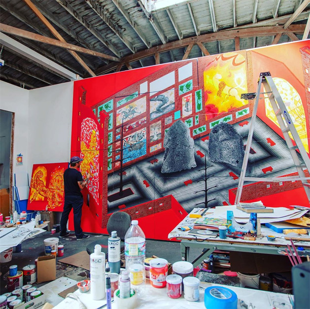 Andrew Schoultz in his studio