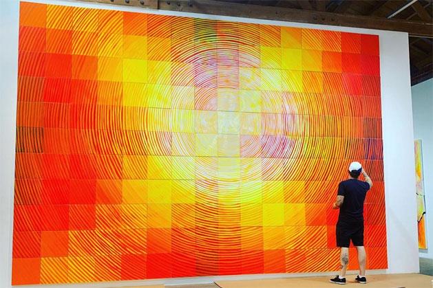 Artist Andrew Schoultz installing his work at DENK Gallery