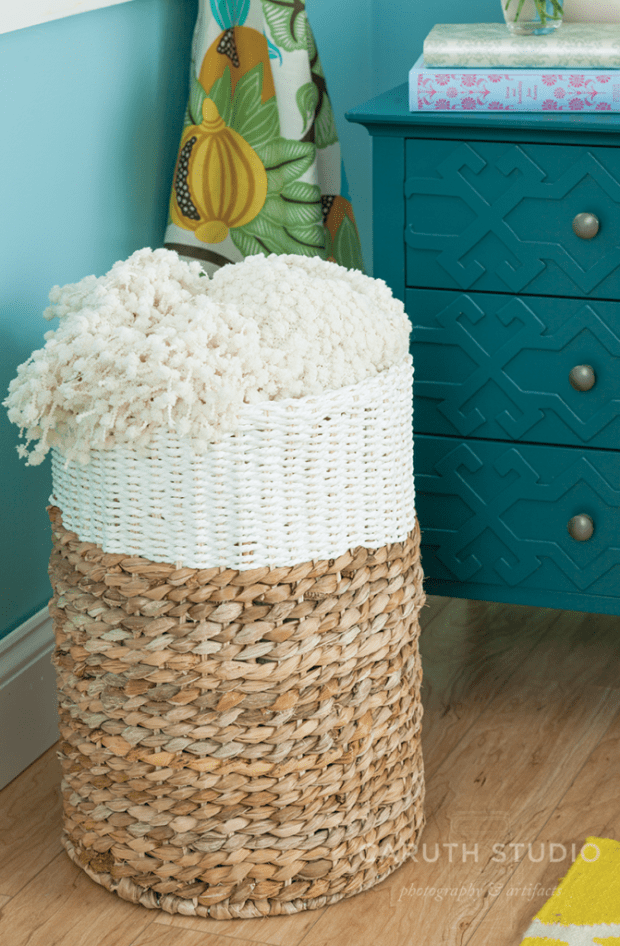 Banded basket with a fluffy white blanket in it