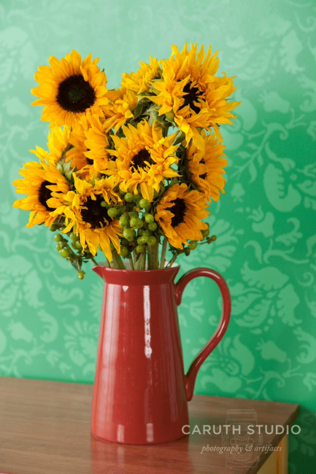 Red pitcher with sunflowers