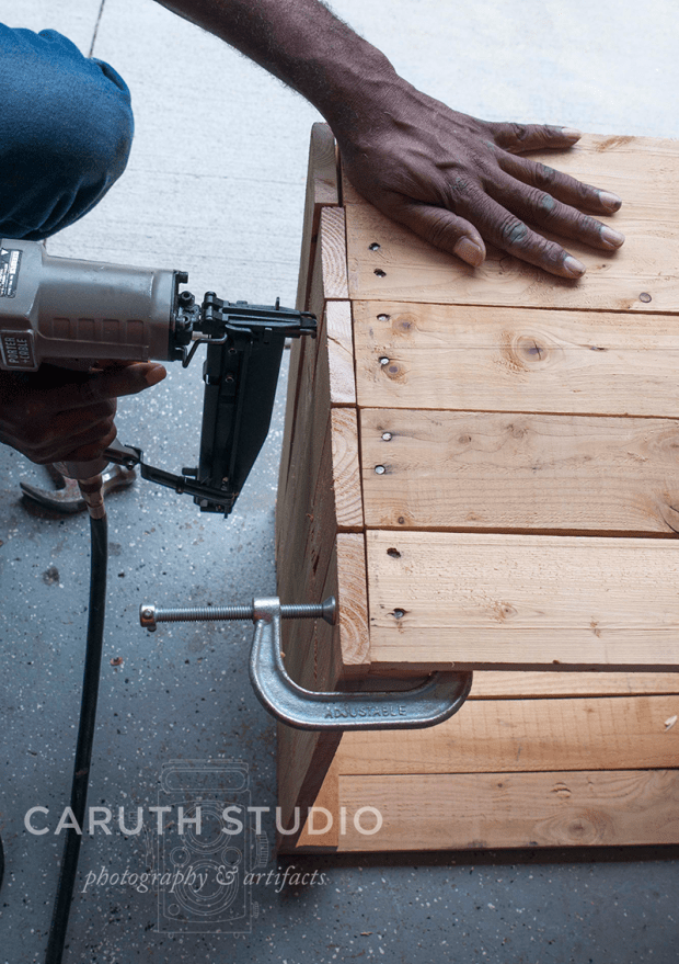 Nail planks in place