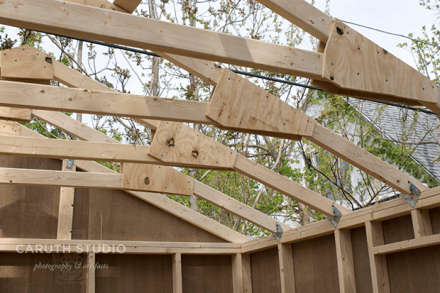 Place trusses in hangers