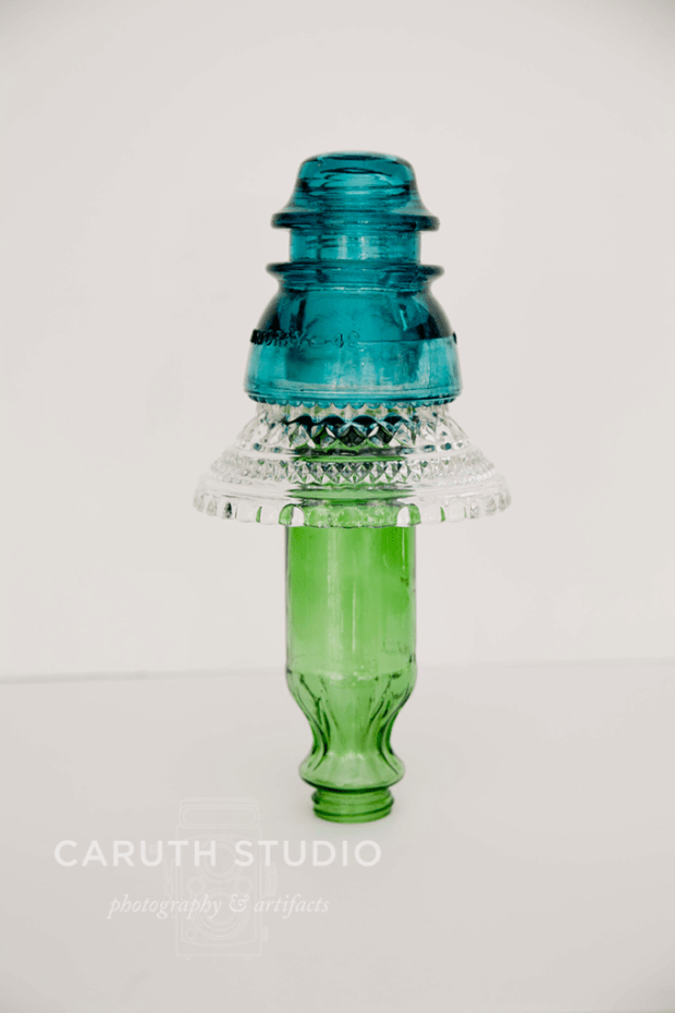 Glass totem with bottle
