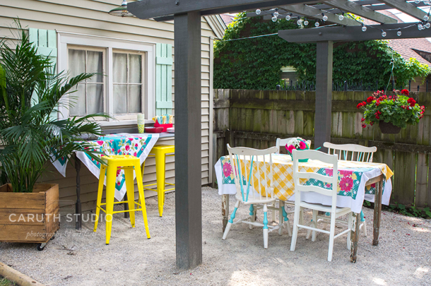 summer patio party setting under the pergola