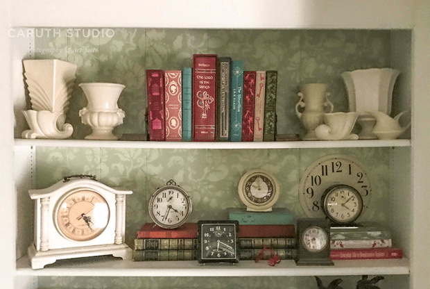 bookcase with stenciled wall at the back
