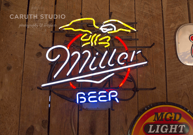 Decorating with a vintage beer sign.
