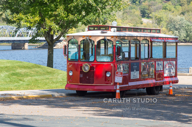 red trolly car next to the river