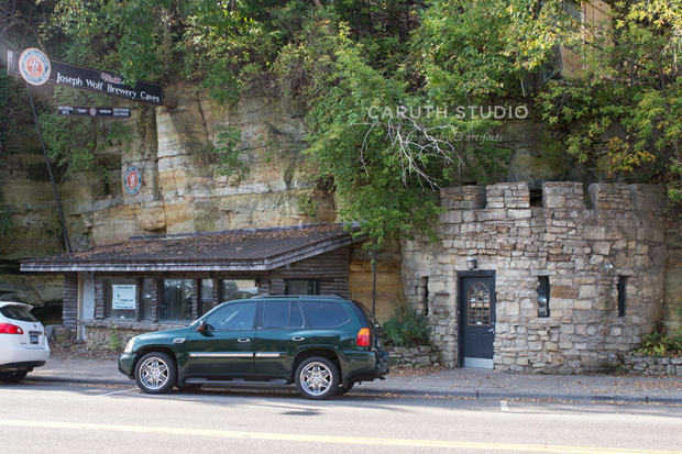 the front of the grotto pub built into the hillside of stillwater with outdoor patio