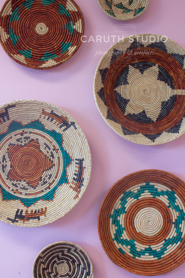 african disc baskets hanging on the wall