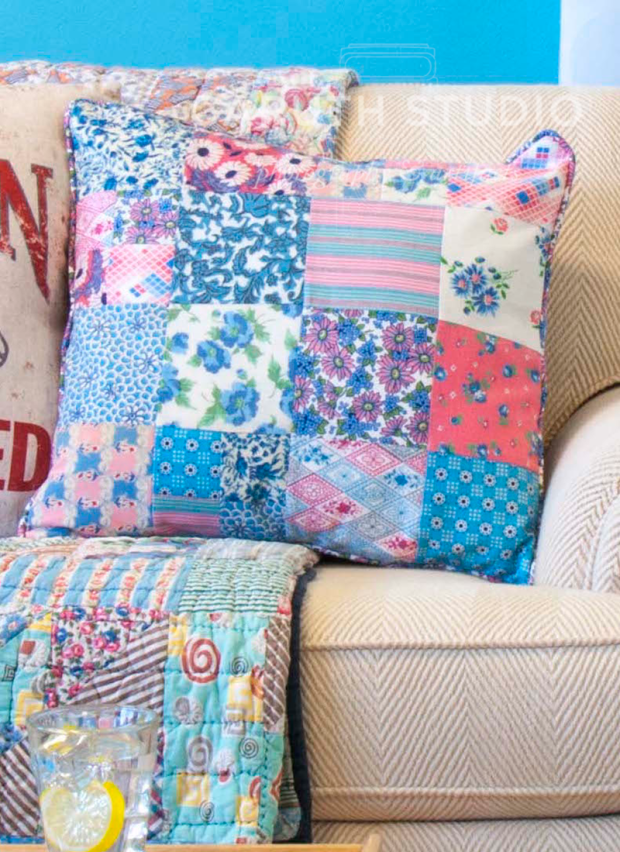 blue and pink patchwork pillow