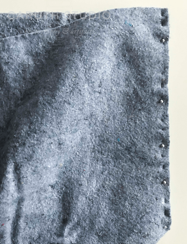 pinning edges of felt